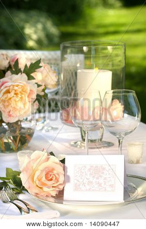 Place setting and card on a table at a wedding reception