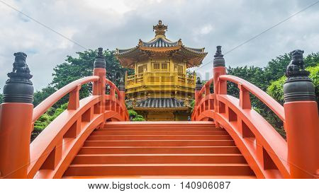 Golden pavilion with Chinese style architecture in Nan Lian garden Hong Kong in sunny day.