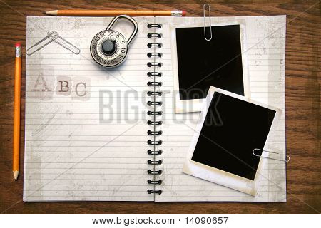 White copy book, pencils and instant photo on oak surface