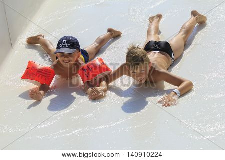 Rhodes Greece-July 30 2016: the young boys on the  mat racer slide in Water park . Mat racer slide is very popular