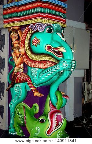 Singapore - December 16 2007: Turquoise elephant statue with Indian man astride its back at the Sri Shrimivasa Perumal Hindu temple in Little India *