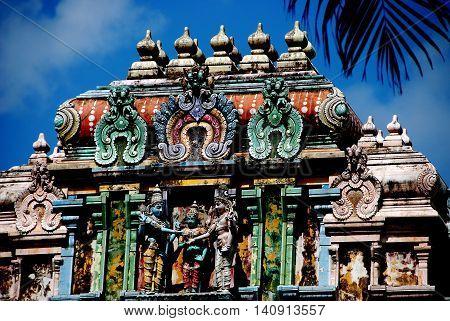 Singapore - December 21 2007: The Amalaka cushion-shaped finial atop the Gopuram Sikhara entrance tower to 1958-1983 Thendayuthapani Hindu Temple on Tank Road