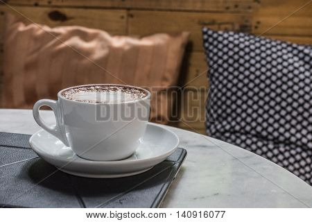 hot fresh coffee in white cup on marble table on tablet and white saucer cappuccino coffee mocha coffee espresso coffee latte coffee