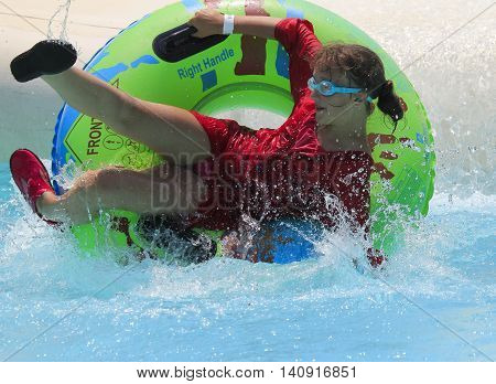 Rhodes Greece-July 31 2016:The girl after rafting slide in the Water park.Rafting slide is one of many popular game for adults and children in park. Water Park is located on the island of Rhodes in Greece and one of the most largest in Europe