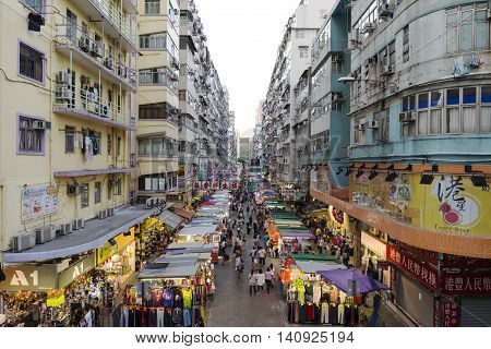 The Fa Yuen Street in Mong Kok, Hong Kong on Jul 23, 2016. It  is a retail street with shops and hawker stalls selling bargain-priced fashion and casual wear for men, women and children and they usually open between 10:30 and 22:30 daily.