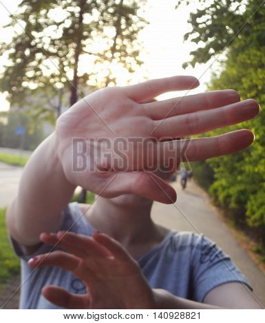 Not shoot sign by hand. Woman pop up palm not allowing to shoot her face