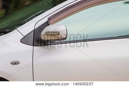 close up Wing mirror on a white car