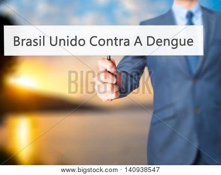 Brasil Unido Contra A Dengue (brazil Against Dengue In Portuguese) - Businessman Hand Holding Sign