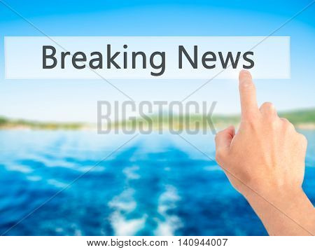 Breaking News - Hand Pressing A Button On Blurred Background Concept On Visual Screen.