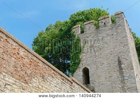 tower of old fortress on a background of sky and trees in Istanbul