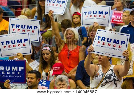Mechanicsburg PA - August 1 2016: Supporters of Presidential candidate Donald J. Trump enthusiastically wave signs at a political rally in Pennsylvania.