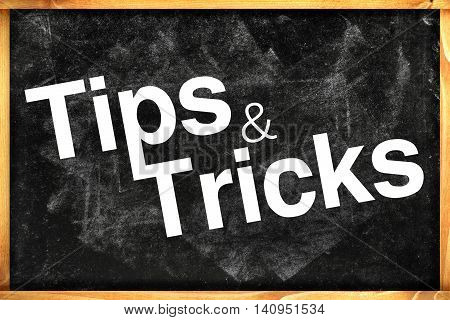 Tips and tricks title on black chalkboard
