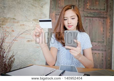 Photo Of A Beautiful Young Female Shopping Online And Paying With A Credit Card.