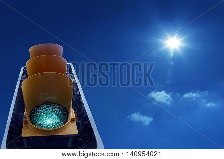 close up shot of traffic light and green light .
