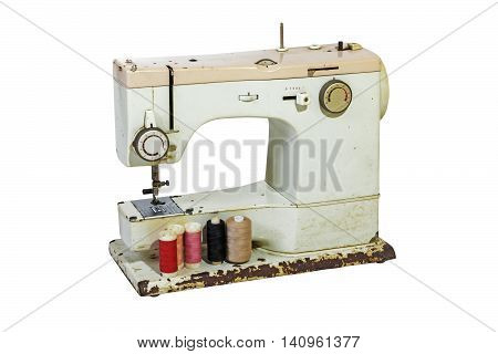 Old Rusty Sewing Machine With Colored Cottons
