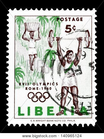 LIBERIA - CIRCA 1960 : Cancelled postage stamp printed by Liberia, that shows Weight Lifter and Porter.