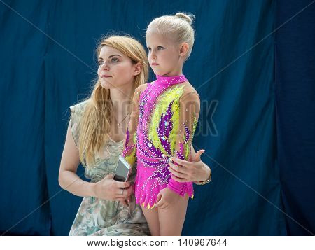 Warsaw Poland - June 25 2016:A coach provides the last minute tips and hints before the gymnastics show