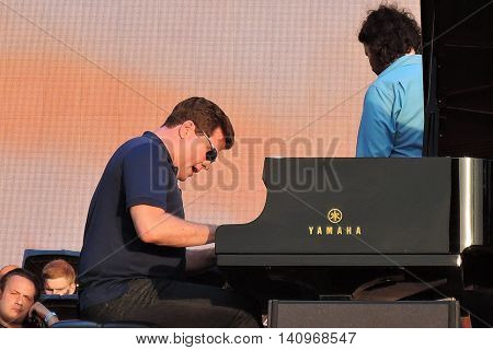 MOSCOW - AUGUST 01, 2016: Piany player Denis Matsuev performs at open air free entrance concert at VDNH park in Moscow. Celebration of VDNH foundation anniversary (77 years).