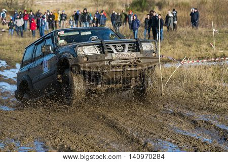 LvivUkraine- December 6 2015: Unknown rider on the off-road vehicle brand Nissan Patroll overcomes a route off road near the city of Lviv Ukraine