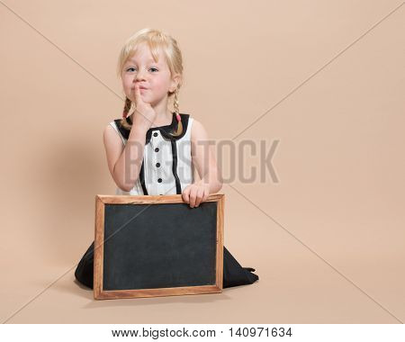 Pre-School child with blank blackboard - plenty of copy space and blank board for designer to write their own message