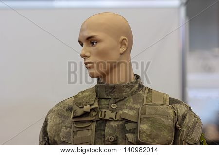 Mannequin in camouflage uniforms infantryman closeup.
