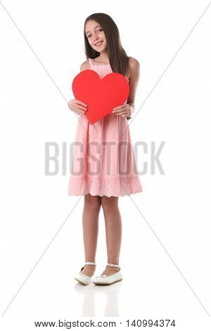 Lovely girl holding a red heart shape over white background. Love concept