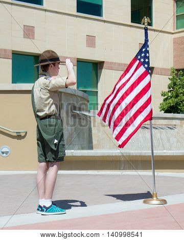 MERIDIAN IDAHO/USA - JULY 30 2016: Boy scouts Salutes the flag at the start of the pro police rally in Meridian Idaho