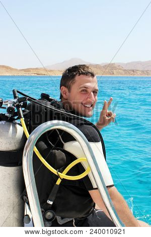 Happy Young Diver In A Suit For Diving Is Preparing To Dive.