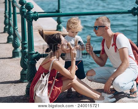 Mother And Father With Son Eat Ice Cream At Sea. Summer Vacation Of Happy Family. Child With Father