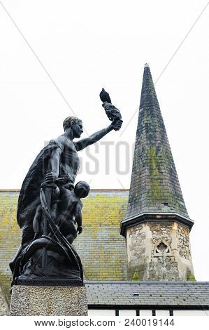 Kingston Upon Thames, United Kingdom - April 2018: Bronze Statue Of A Man And Two Children Situated