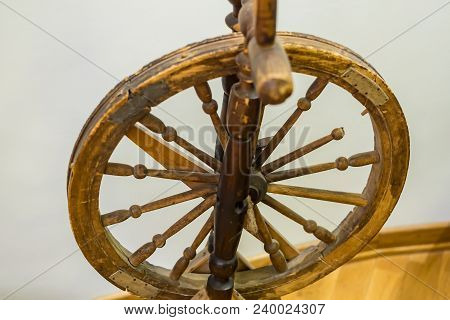 Closeup Of Antique Wooden Spinning Wheel Indoors
