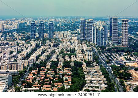 Aerial view of residential buildings and modern office towers in Tel Aviv, Israel.