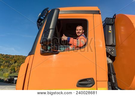 Waste collector driving Garbage truck giving thumbs up from the window poster