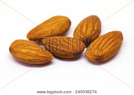 Almond Nut Isolated On White Background. Yellow Nut Pile Closeup Photo. Simple Organic Food. Tasty H