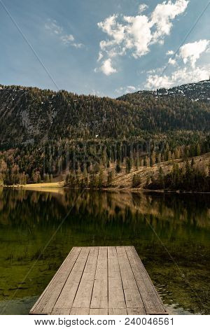 A Footbridge With Some Great Reflection Of The Ferchensee And The Mountains