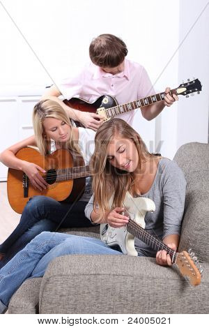 portrait of teenagers playing the guitar