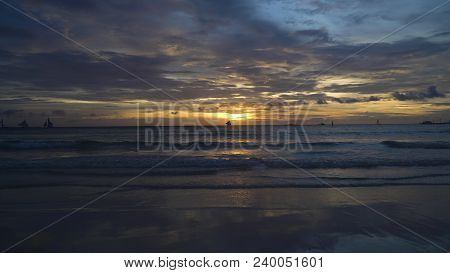 Sunset Over The Sea In The Background Boats, Sailing Boat, Orange Sky And Islands. Sailing Boats At