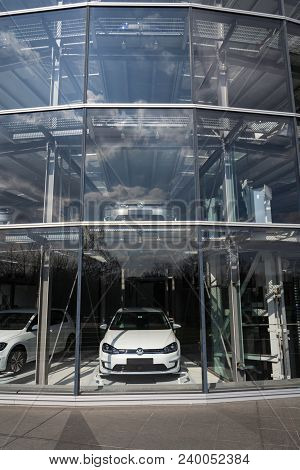 Dresden, Germany - April 2 2018: Plug-in Hybrid Volkswagen E-golf Electric Cars Stands Behind Glass