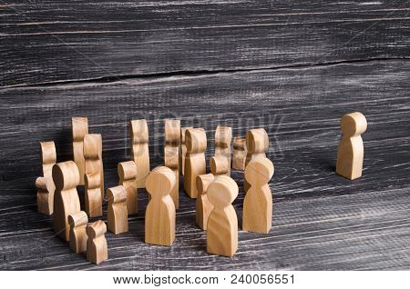 A Crowd Of People Is Standing And Looking At A Lonely Man Standing. People Follow The Leader, The Bo