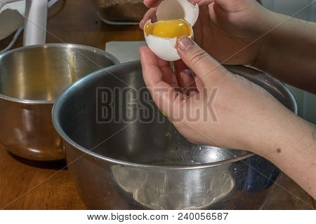 Using An Egg Shell To Separate Egg Yolk