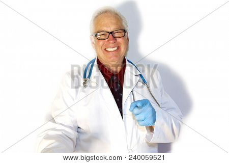 Handsome Male Doctor or Medical Professional against a white wall with shadows. Isolated on white. Room for text