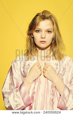 One Sleepy Young Sensual Strange Blonde Woman In Satin Pink Dressing Gown In Soft Flower Pattern Pas