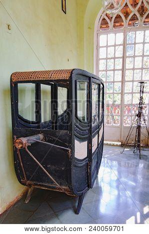Goa, India - November 16, 2012: Hand Crew Is Standing By The Window Of Menezes Braganza Pereira Hous