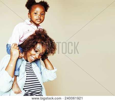 Adorable Sweet Young Afro-american Mother With Cute Little Daughter, Hanging At Home, Having Fun Pla
