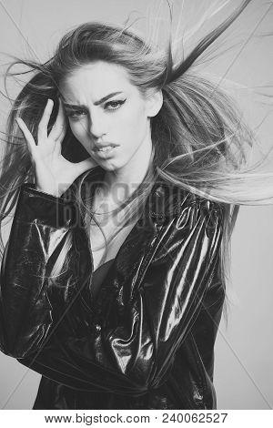 Lady Sexy In Slicker Or Raincoat Suffers Headache. Girl With Long Hair Wears Black Cloak, Grey Backg