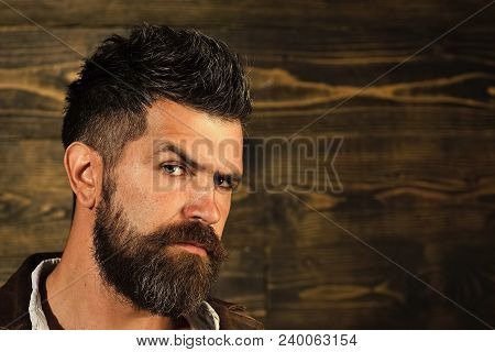 Man With Beard And Mustache On Wooden Background. Haircut Of Bearded Man, Archaism. Fashion And Male