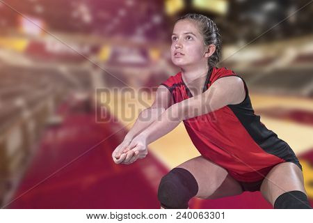 Female Professional Volleyball Player In Action On Grand Court