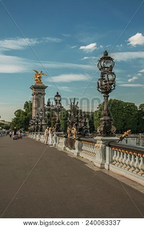 Paris, France - July 07, 2017. People On Elegant Alexandre Iii Bridge Over The Seine River In Paris.