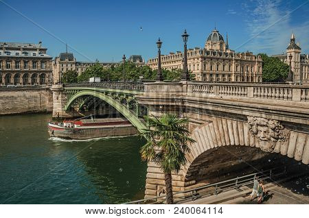 Paris, Northern France - July 08, 2017. Bridge Over The Seine River And The Conciergerie Building Wi