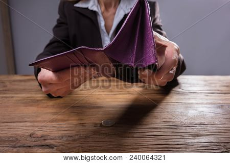 Businessperson Holding Empty Purse